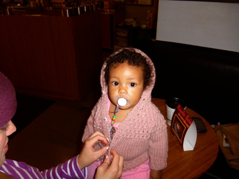 Nyah inherited that sweater from Kimmy's own infancy.